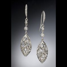 Lush open wirework drop style earrings with diamond accents. Created by Christopher Duquet Fine Jewelry Design. #earrings #diamonds #dropearrings