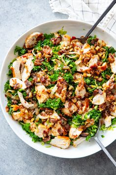 This kale salad is packed to the max with goodies Kale is tossed with shredded Brussels sprouts lots of sweet caramelized onions crispy bacon and grilled chicken plus a super tasty hot bacon dressing It s dairy free and paleo with both and keto options Paleo Kale Salad, Kale Chicken Salad, Kale Salad Recipes, Healthy Recipes, Kale Salads, Paleo Food, Paleo Diet, Recipes With Kale, Avocado Salads