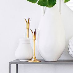 Gild your nest: Pick a metallic and sprinkle it throughout the room in a handful of pieces.