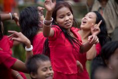Young Rakhine women in traditional dress dance to music during the Buddhist Water Festival (New Year) celebrations in the village of Harbang north of Cox's Bazar