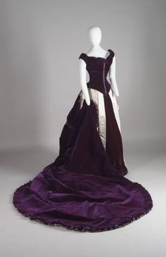 c. 1880s Charles Frederick Worth designed the gown of purple silk velvet, and combined it with lavender peau de soie, a heavy satin. Story of owner if you click link.