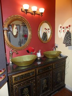 master bath with vintage asian vanity, green glass vessel sinks and vintage gold mirrors