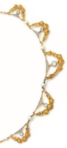 An antique gold, diamond and pearl garland necklace, circa 1900. #antique #necklace