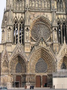 Gothic style, Reims Cathedral in France, was completed in 1275.  The facade detail and windows are a work of art!