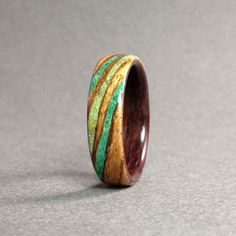 Hey, I found this really awesome Etsy listing at https://www.etsy.com/listing/223407881/zebrawood-bentwood-ring-with-tibetan