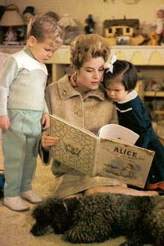 """""""Grace Kelly at Home,"""" from """"Picture of Elegance Blog"""" -- Princess Grace reading """"Alice..."""" to Prince Albert, Princess Stephanie, and poodle."""