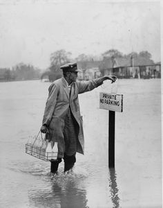 vintage everyday: Milkman making his deliveries despite the flood in Buckinghamshire, 1954