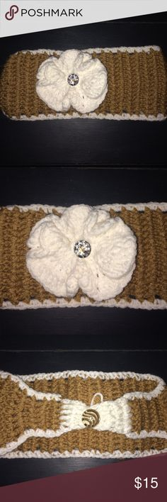 Handmade Knitted Headband Handmade Knitted headband with a knitted flower attached with a diamond in the middle. Super cute winter accessory. So soft & cozy. Keep you warm these winter months!! Accessories Hair Accessories
