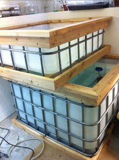 Adding wood trim to a aquaponics tank! Looks great and you can add the wood slats at this point to had the tank and planter tank:)