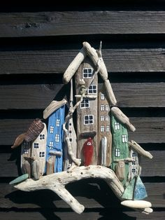 Image result for driftwood houses art wall