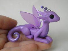 Lilac polymer clay dragon with gem.