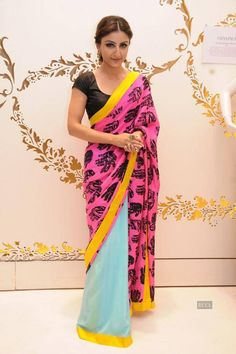 We're a big fan of Masaba's colour-block sari worn by Soha Ali Khan at an event. This blue and pink sari has a bright yellow border which highlights the attire. This sari is perfect for day wear. Indian Dresses, Indian Outfits, Indian Clothes, Ethnic Outfits, Desi Clothes, Emo Outfits, Satya Paul Sarees, Designer Silk Sarees, Bollywood Dress