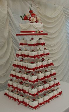 Square Mini Wedding Cakes with a top cake for cutting to compliments the display.  All flowers are made from sugar.  More about my mini cakes at http://www.annescakecreations.co.uk/mini_cakes.html
