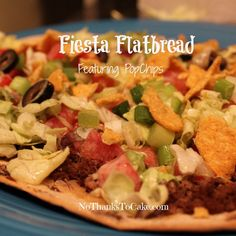 fiesta flatbread #recipe - cheesy mexican pizza topped with veggies and #tortilla #popchips.