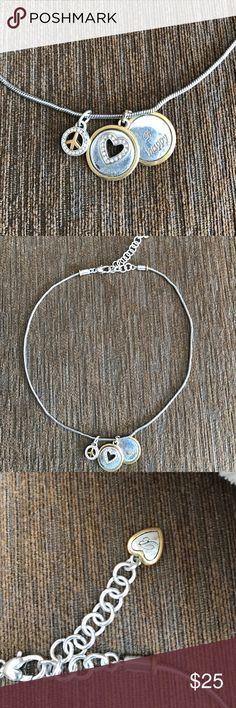 """Brighton Be Happy Charm Necklace with pouch. This necklace had three charms. One small piece sign one silver and gold heart and one that a says B happy. Very sweet necklace. Measures 17"""" long. Brighton Jewelry Necklaces"""