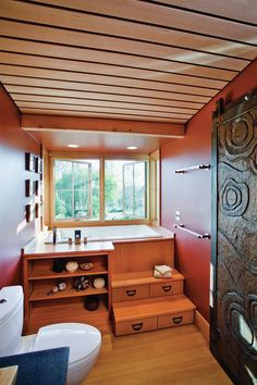 The 18-inch-deep bathtub is a drop-in standard model from Kohler that fits in a 5-foot alcove. The bath area is built into a window bay that cantilivers out into the garden. Stepped Douglas fir cabinetry in the Asian tansu style makes the most of a small room, adding storage space as well as visual interest. Idea Garden, Healdsburg, Calif. Architect: Arkin Tilt Architects, Berkeley, Calif.; Builder: Earthtone Construction, Sebastopol, Calif.; Cabinet Maker: Higgins Cabinetry, Duncans Mills…