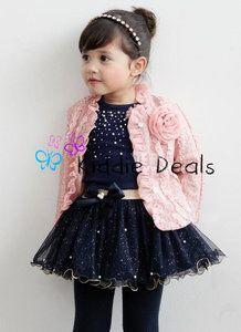 3-delig setje Eva bestaat uit een blauwe tule rok met glitters, blauwe top met parels en een roze jasje/vestje.