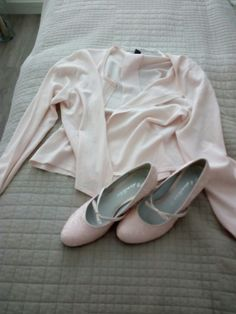Lovely, pink shoes snd a cardigan.