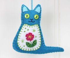 Felt cat ornament with flower embroidery