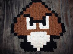 Crocheted Goomba Rug from Super Mario Bros.  I'll get a better pic of this up soon!