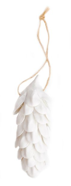 Porcelain Pinecone Ornament. $16.00. Delicate layers of porcelain form a woodland inspired pinecone ornament, crafted with a matte finish. Twine loop for hanging.