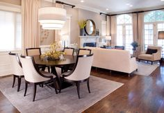 Image from http://www.homeandtables.com/wp-content/uploads/2014/10/Round-Dining-Table-For-8-10-Dining-Room-Transitional-with-area-rug.jpg.