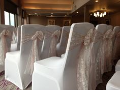 White lycra covers with entwined pale dusky pink & white lace sashes