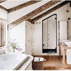 black outlines shower and spanish tile on inside of shower