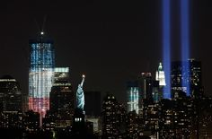 The Tribute in Light shines above lower Manhattan, the Statue of Liberty, and One World Trade Center, left, on September 10, 2011 in New York, one day before the 10th anniversary of the September 11, 2001 attacks on the United States.
