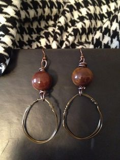 brown wire with brown beads...  facebook.com/farrarjewelrycreations