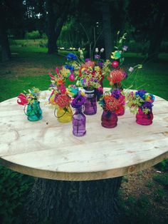 Festival, colourful, bright and crazy styled bottles and jars with rainbow roses, newtons, celoscia, achmilla, gloriosa, lisianthus x