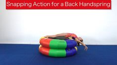 Snapping Action in a Back Handspring The success of a back handspring is dependent on a quick snap back position that starts from an exaggerated hollow shape. Back Handspring, Snap Backs, Training Tips, Cheerleading, Martial Arts, Gymnastics, Action, Youtube, Success