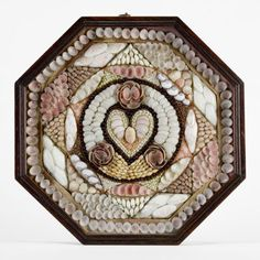 A single leaf sailor's shell valentine centred with an appropriate shell work heart and within a cedarwood case. Barbados circa 1850.