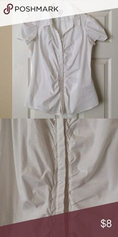 Cute Fitted Blouse Cute white blouse with short cap sleeves. Has a cool braided fabric detail along the button band. Also has a hidden button placket. Fabric is stretchy for comfort. Worthington Tops Blouses
