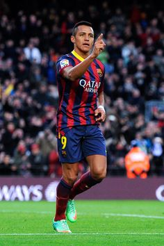 Alexis Sanchez of FC Barcelona celebrates after scoring his team's third goal during the La Liga match between FC Barcelona and Elche FC at Camp Nou on January 5, 2014 in Barcelona, Catalonia.