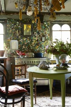 The home of artists Genevieve Carroll and Bill Moseley in Hill End. The splashback is a mosaic of old ceramics and bottles.