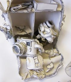 Close up of Collect, Gather & Rummage by Katharine Morling, Earthstone, porcelain and black stain