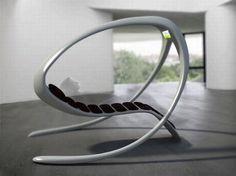 Futuristic concept lounge chair with built-in TV. Concepto de silla Futurista con TV incorporada. Si tuviera también un ps3, no me pararía nunca más.