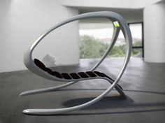 Futuristic concept lounge chair with built-in TV. This would make a cool rocking chair with a few changes