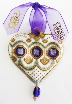 Gold and Purple Heart ornament stitched by Carolyn S.