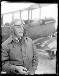 1923 photograph of a man standing next to an airplane.  I wish people still dressed like this when they flew!  Look at those goggles! (Maine Historical Society)