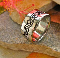 Titanium Irish Celtic Promise Ring with Hearts In Black Ck25. $239.00, via Etsy.