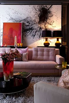 Eclectic mix of colours - pink, red, black. Love the huge painting!