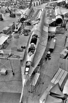"""The final of 12 ordered by the CIA A-12 """"Oxcart"""" is seen in production at the Skunk Works plant in Burbank, California (June 1964). Equipped with twin Pratt & Whitney J-58 engines, the A-12 reached speeds of Mach 3.35 (2,210 mph) at 75,000 feet. Its service ceiling was 95,000."""