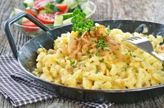 Delectable German Dish: Scrumptious Spaetzle And Cheese  Really good! (Note: Don't add the butter to the Spaetzle dough.   There  is a misprint.  Should be used to fry them.)