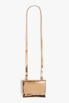 Capture a bit of rosy sunset glow with this super glam long strap shoulder bag.