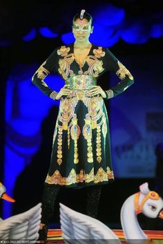 Hemangi Parte showcases a creation by designer Manish Arora on Day 4 of Delhi Couture Week, held in New Delhi, on August 03, 2013.