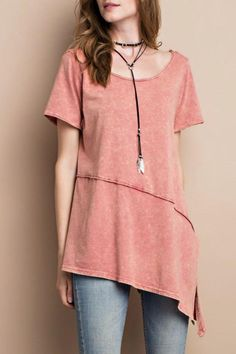 2c27bcd97e196 Boat neck tee with an asymmetrical bottom and a seam across the front.  Fabric is