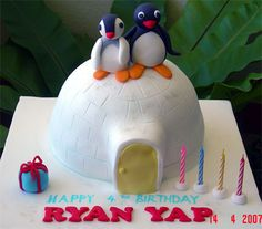 Pingu cake, but wrong colors on the characters-their skin color is black not blue, but cute as a button & very well done.