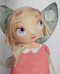 papier mache. I wish I could remember this artists name. She's French...I love her talent.